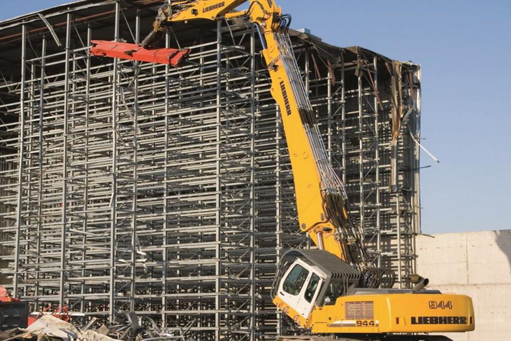 Liebherr R944c demolition equipment taking down a building structure